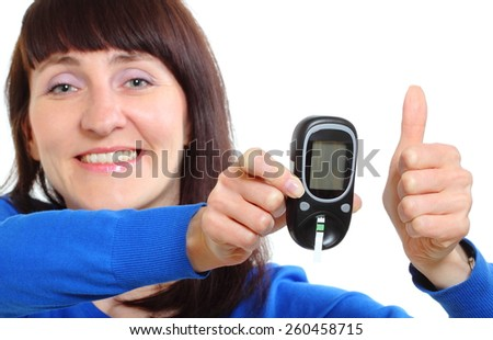 Smiling woman holding glucose meter and showing thumbs up, measuring sugar level, concept for diabetes. Isolated on white background