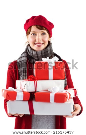 Smiling woman holding large presents on white background - stock photo