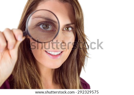 Smiling woman holding magnifying glass on white background