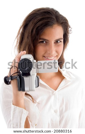 smiling woman holding video camera on an isolated background - stock photo