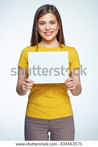 Smiling woman holding white sign board. Casual dressed girl with advertising banner.