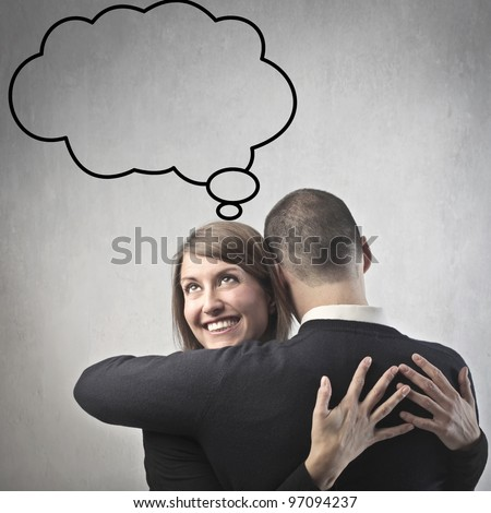 Smiling woman hugging her husband and thinking about something