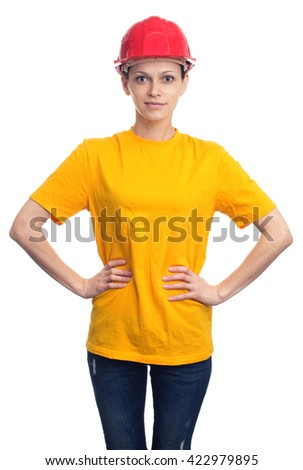 smiling woman in a protective helmet and yellow t-shirt. Isolated over white - stock photo