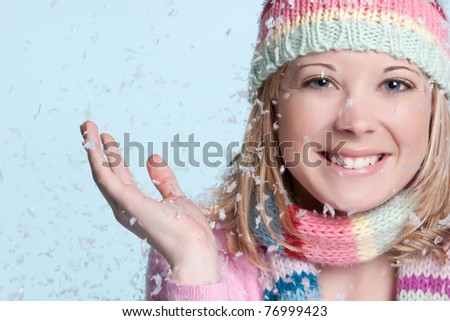 Smiling woman in falling snow - stock photo