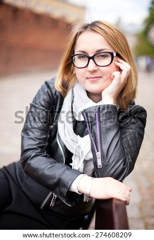 Smiling woman in glasses - stock photo