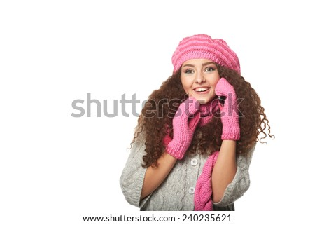 Smiling woman in knit winter clothing speaking mobile.Isolated on white - stock photo