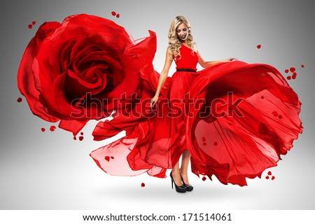 smiling woman in large flying rose dress - stock photo