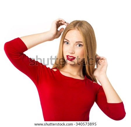 smiling woman in red posing against white background. studio isolated. long hair