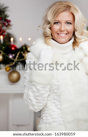 smiling woman in santa helper hat with gift box - stock photo