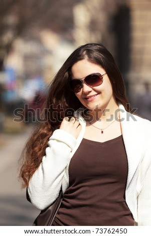Smiling woman in spring - stock photo