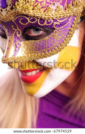 smiling woman in the half mask from Venice, isolated on white - stock photo