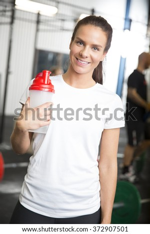 Smiling woman in workout outfit at fitness gym