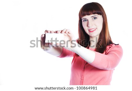 Smiling woman is showing business card. Focus on card. - stock photo