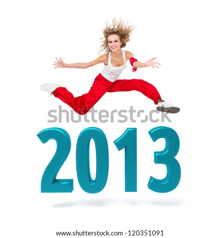 Smiling woman jumping over a 2013 New Year sign against isolated white background - stock photo