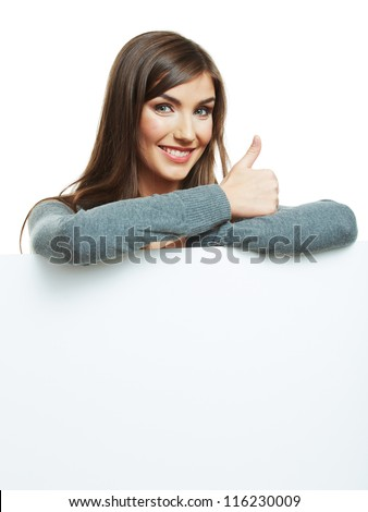 Smiling woman leaning on big blank board . Close up female face portrait with arms on blank card. Thumb up. - stock photo