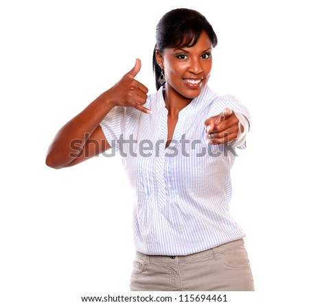 Smiling woman looking and pointing at you saying call me on isolated background - stock photo
