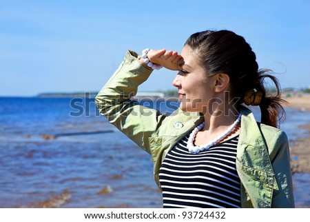 Smiling woman looking at the sea