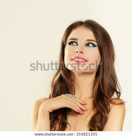 Smiling Woman looking up - stock photo