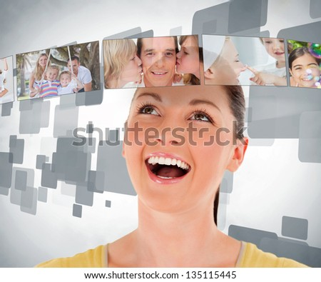Smiling woman looking up at a picture bar
