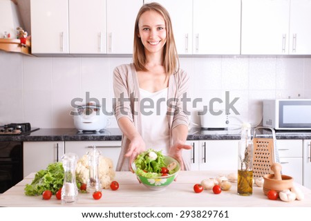 smiling woman making healthy food in kitchen