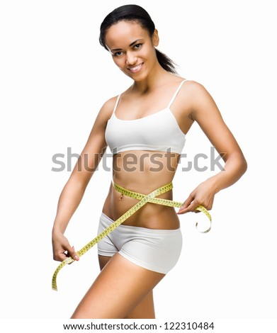 Smiling woman measuring perfect shape of beautiful waist. Healthy lifestyles concept