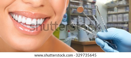 Smiling woman mouth with great teeth. Over dental office background  - stock photo