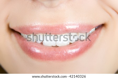 Smiling woman mouth with white teeth closeup
