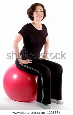 smiling woman on fitness ball - stock photo