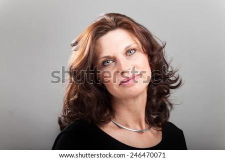smiling woman on grey  - stock photo