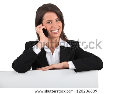 Smiling woman on the phone - stock photo