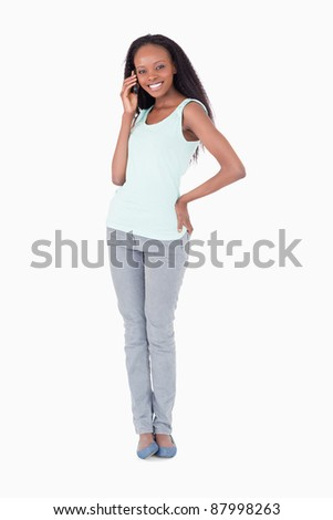 Smiling woman on the phone on white background - stock photo