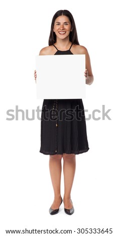 Smiling woman portrait isolated on white background holding a blank board - stock photo