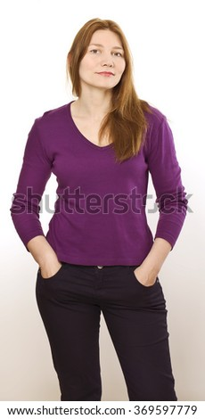 Smiling woman portrait with purple shirt.