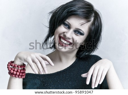 smiling woman portrait with white teeth and red lipstick - stock photo
