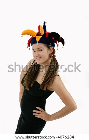 smiling woman posing over white, wearing funny court jester hat