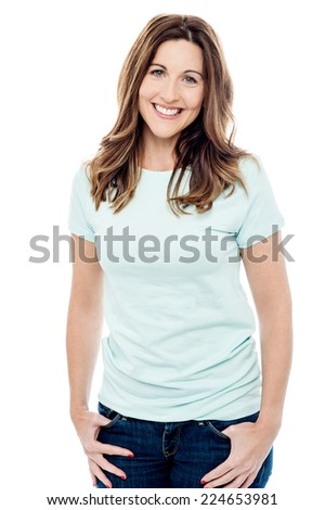 Smiling woman posing with hands in pockets - stock photo