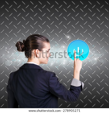 Smiling woman pressing digital button. Metal background - stock photo