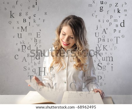 Smiling woman reading a book with letters flying away from it