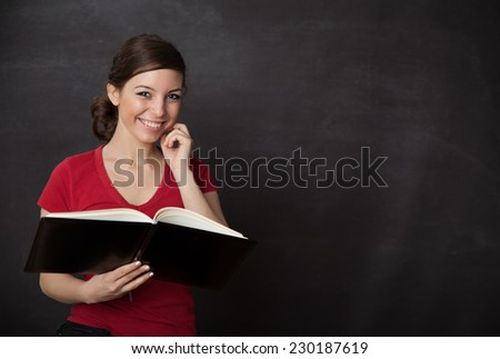 Smiling woman reading. Blackboard/chalkboard concept