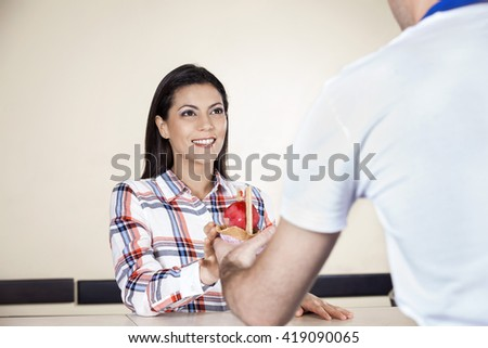 Smiling Woman Receiving Ice Cream From Waiter