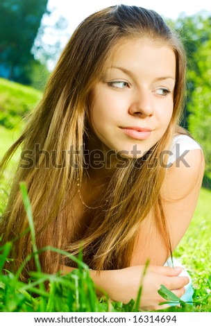 Smiling woman relaxes on the grass