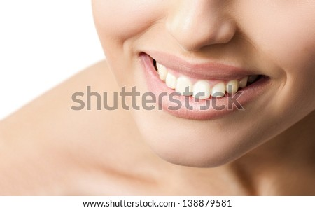 Smiling woman's mouth with beautiful white teeth on  white background