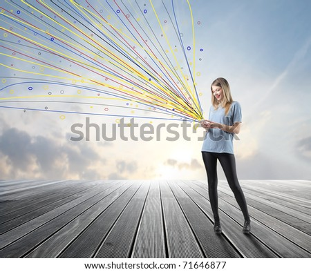 Smiling woman sending messages with her mobile phone - stock photo