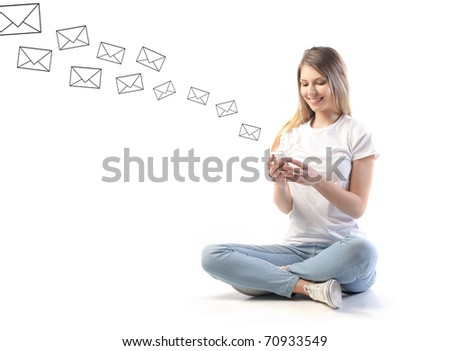 Smiling woman sending sms from a mobile phone - stock photo