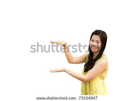 Smiling woman showing copy space for product / message isolated on white background.