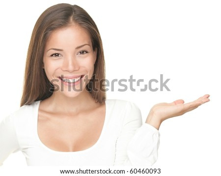 Smiling woman showing copy space for product with open hand palm - smiling friendly expression, Isolated on white background. Mixed Asian / Caucasian model. - stock photo