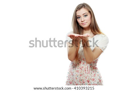 Smiling woman showing open hand palm with copy space for product or text - stock photo