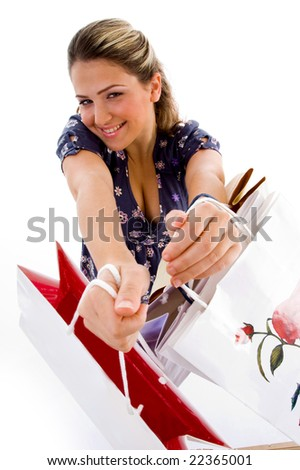 smiling woman showing shopping bags with white background - stock photo
