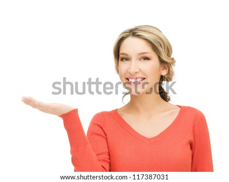 smiling woman showing something on the palm of her hand - stock photo