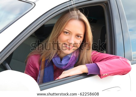 Smiling Woman Sitting In A Car - stock photo